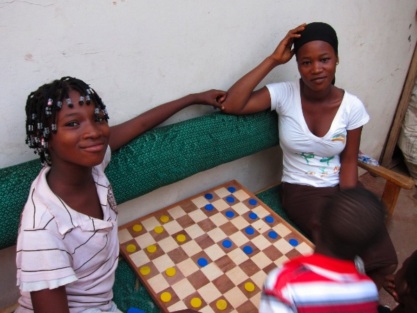 playing checkers in Ghana